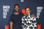 Actors Ethan Herisse (L) and Aunjanue Ellis attend FYC Event For Netflix's 'When They See Us' at Paramount Theater on the Paramount Studios lot on August 11, 2019 in Hollywood, California.