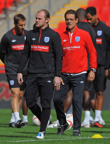 wayne rooney england. Wayne Rooney and Fabio Capello