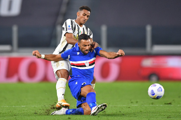 Juventus v UC Sampdoria - Serie A [photo,sports,team sport,ball game,player,soccer,football player,soccer player,sport venue,sports equipment,football,fabio quagliarella,luiz da silva danilo,v,team sport,sports,juventus,uc sampdoria,serie a,match,team sport,international rules football,tackle,ball,tournament,rugby sevens,rugby football,stadium,championship]