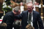 (AFP-OUT) Former President George W. Bush embraces former Secretary of State James Baker, right, after he gave a eulogy during the funeral for former President George H.W. Bush at St. Martin's Episcopal Church, on December 6, 2018 in Houston, Texas. President Bush will be buried at his final resting place at the George H.W. Bush Presidential Library at Texas A&M University in College Station, Texas. A WWII combat veteran, Bush served as a member of Congress from Texas, ambassador to the United Nations, director of the CIA, vice president and 41st president of the United States.