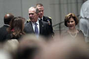 (AFP-OUT) Former President George W. Bush and his wife Laura Bush arrive for a funeral service for former President George H.W. Bush at St. Martins Episcopal Church on December 6, 2018 in Houston, Texas. President Bush will be buried at his final resting place at the George H.W. Bush Presidential Library at Texas A&M University in College Station, Texas. A WWII combat veteran, Bush served as a member of Congress from Texas, ambassador to the United Nations, director of the CIA, vice president and 41st president of the United States.