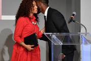 Dr. Precious Moloi-Motsepe and Aldis Hodge speak onstage during Fashion 4 Development's 8th Annual Official First Ladies Luncheon at The Pierre Hotel on September 25, 2018 in New York City.