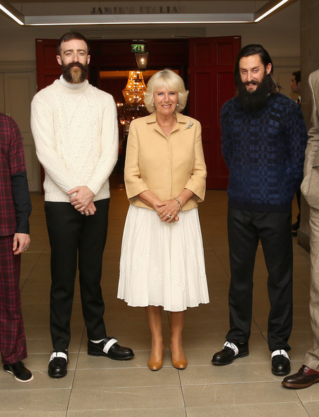 Camilla, Duchess of Cornwall poses with male models at the Fashion Festival in the Assembly Rooms on July 22, 2014 in Edinburgh, Scotland.