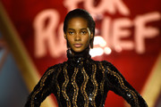 Tami Williams walks the runway at the Fashion for Relief event during the 70th annual Cannes Film Festival at Aeroport Cannes Mandelieu on May 21, 2017 in Cannes, France.
