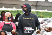 2 Chainz (R) his wife Kesha Ward Epps and son Halo Epps attend the Feed Your City Challenge on September 19, 2020 in Atlanta, Georgia. Feed Your City Challenge provided Atlanta's local community members with boxes of fresh groceries, PPE items, and voter registration stations.
