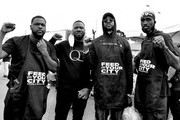 Image has been converted to black and white. The color version is available.) Feed Your City Challenge Co-Founder Tony Draper, Pierre Pee Thomas, 2 Chainz, and Feed Your City Challenge Co-Founder Ricky Davis attend the Feed Your City Challenge on September 19, 2020 in Atlanta, Georgia. Feed Your City Challenge provided Atlanta's local community members with boxes of fresh groceries, PPE items, and voter registration stations.