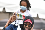 Rapper 2 Chainz and his son Halo Epps attend the Feed Your City Challenge on September 19, 2020 in Atlanta, Georgia. Feed Your City Challenge provided Atlanta's local community members with boxes of fresh groceries, PPE items, and voter registration stations.