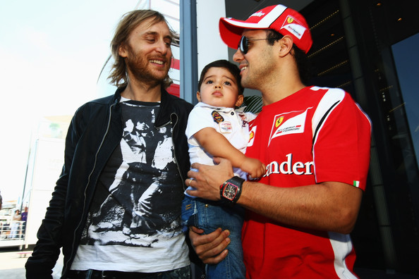 Felipe Massa DJ and producer David Guetta meets driver Felipe Massa as he visits the Ferrari garage at the Valencia Street Circuit before headlining the F1 Rocks in Valencia event held at the Agora on July 24, 2011, in Valencia, Spain.