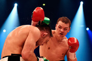 Fedor Chudinov of Russia throws a punch at Felix Sturm of Germany during the WBA Super Middleweight World Championship fight at Koenig-Pilsner Arena on February 20, 2016 in Oberhausen, Germany.