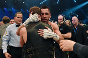 Felix Sturm of Germany hugs Fedor Chudinov of Russia after his WBA Super Middleweight World Championship fight at Koenig-Pilsner Arena on February 20, 2016 in Oberhausen, Germany.