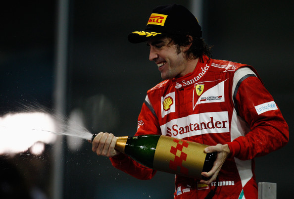 Fernando Alonso Fernando Alonso of Spain and Ferrari celebrates on the podium after finishing second during the Abu Dhabi Formula One Grand Prix at the Yas Marina Circuit on November 13, 2011 in Abu Dhabi, United Arab Emirates.