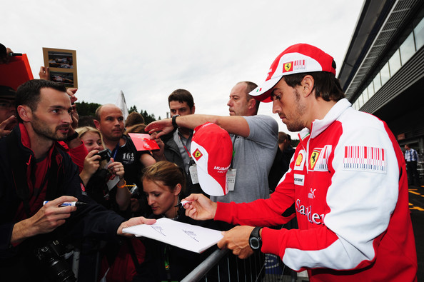 Fernando Alonso Fernando Alonso of Spain and Ferrari signs autographs for fans at the drivers autograph session during previews to the Belgian Formula One Grand Prix at the Circuit of Spa Francorchamps on August 26, 2010 in Spa Francorchamps, Belgium.