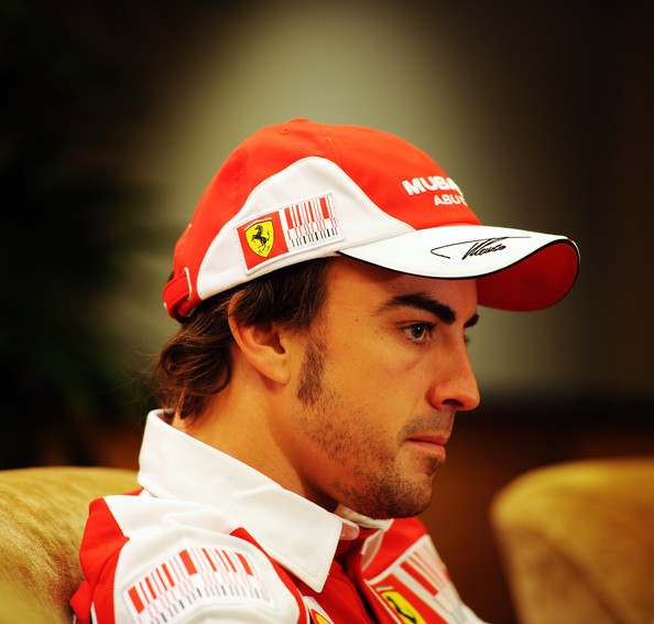 Fernando Alonso Fernando Alonso of Spain and Ferrari is interviewed by members of the media at the Ritz Carlton hotel during previews to the Singapore Formula One Grand Prix on September 23, 2010 in Singapore.