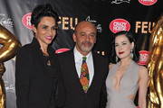 (L-R) Farida Khelfa, Christian Louboutin and Dita von Teese attend 'Feu' Directed By Christian Louboutin VIP Premiere at Le Crazy Horse on March 12, 2012 in Paris, France.