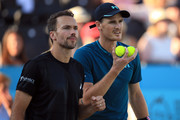 Jamie Murray of Great Britain and Brazil's Bruno Soares react during defeat to Henri Kontinen of Finland and Australia's John Peers during Day 7 of the Fever-Tree Championships at Queens Club on June 24, 2018 in London, United Kingdom.