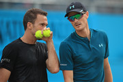 Jamie Murray of Great Britain and Bruno Soares of Brazil (L) talk tactics during their doubles semi-final match against Oliver Marach of Austria and Mate Pavic of Croatia during day six of the Fever-Tree Championships at Queens Club on June 23, 2018 in London, United Kingdom.