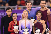 (L-R) Silver medal winners Wenjing Sui and Cong Han of China, gold medal winners Aljona Savchenko and Bruno Massot of Germany and bronze medal winners Meagan Duhamel and Eric Radford of Canada celebrate during the victory ceremony after the Pair Skating Free Skating at Gangneung Ice Arena on February 15, 2018 in Gangneung, South Korea.