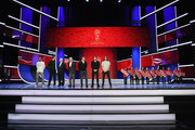 (L-R) Cafu, Laurent Blanc, Nikita Simonyan, Gordon Banks, Fabio Cannavaro; Diego Forlan and Carles Puyol pose with the Super Fans from the host cities after the rehearsal for the 2018 FIFA World Cup Draw at the Kremlin on November 30, 2017 in Moscow, Russia.