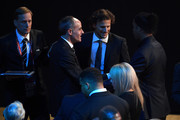 Diego Forlan and Ronaldinho greet during the Final Draw for the 2018 FIFA World Cup Russia at the State Kremlin Palace on December 1, 2017 in Moscow, Russia.
