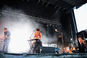 (L-R) Eric Cannata, Sameer Gadhia and Payam Doostzadeh of Young the Giant perform onstage during day 2 of the Firefly Music Festival on June 20, 2014 in Dover, Delaware.