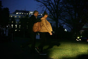U.S. President Barack Obama (L) and daughter Sasha (R) walk towards the Marine One on the South Lawn prior to their departure from the White House December 18, 2015 in Washington, DC. President Barack Obama is traveling to San Bernardino, California, to meet with families of victims of the terrorist attack. Then, the first family will continued their journey to Hawaii for Christmas and New Year vacation until January 3rd, 2016.
