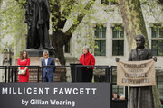 British Prime Minister Theresa May (R) gives a speech as Mayor of London Sadiq Khan and activist Caroline Criado-Perez look on during the official unveiling of a statue (R) in honour of the first female Suffragette Millicent Fawcett in Parliament Square on April 24, 2018 in London, England. The statue of women's suffrage leader Millicent Fawcett is the first monument of a woman and the first designed by a woman, Turner Prize-winning artist Gillian Wearing OBE, to take a place in parliament Square.
