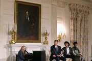 "Music artist Melissa Etheridge (L) performs the song ""Stormy Weather"" during a workshop titled ""I'm Every Woman: The History of Women in Soul"" with (L-R) Grammy Museum Executive Director Robert Santelli and music artists Janelle Monae and Patti LaBelle in the State Dining Room at the White House March 6, 2014 in Washington, DC. As part of a concert honoring women in soul music, First Lady Michelle Obama hosted the workshop for 124 students from middle school, high school and colleges from across the country."