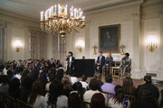 "Soul music artist Janelle Monae (C) performs during a workshop titled ""I'm Every Woman: The History of Women in Soul"" in the State Dining Room with (L-R) Grammy Museum Executive Director Robert Santelli and music artists Melissa Etheridge and Patti LaBelle at the White House March 6, 2014 in Washington, DC. As part of a concert honoring women in soul music, First Lady Michelle Obama hosted the workshop for 124 students from middle school, high school and colleges from across the country."