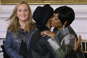 "(L-R) Music artists Melissa Etheridge, Janelle Monae and Patti LaBelle participate in a workshop titled ""I'm Every Woman: The History of Women in Soul"" in the State Dining Room at the White House March 6, 2014 in Washington, DC. As part of a concert honoring women in soul music, First Lady Michelle Obama hosted the workshop for 124 students from middle school, high school and colleges from across the country."