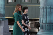 U.S. first lady Melania Trump and Japan's first lady Akie Abe walk together during a tour of the Flagler museum on April 18, 2018 in Palm Beach, Florida. The first ladies accompanied their husbands U.S. President Donald Trump and Japan's Prime Minister Shinzo Abe to Palm Beach.