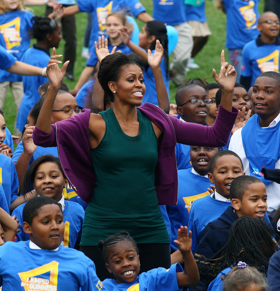 First lady Michelle Obama does jumping jacks with 400 school children on the South Lawn of the White House, on October 11, 2011 in Washington, DC. First lady Michelle Obama led local school children in doing one minute of continuous jumping jacks while attempting to help break the Guinness world record.