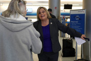 Rep. Ileana Ros-Lehtinen (R-FL) greets a person after speaking to the media about President Donald Trump's new executive order barring US entry for natives of seven Muslim-majority countries before she boarded a plane to Washington, DC at the Miami International Airport on January 30, 2017 in Miami, Florida. Ros-Lehtinen said among other things that any future executive order from President Donald Trump on any issue should comply with existing laws and regulations.