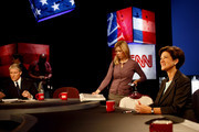 Gubernatorial candidate Alex Sink goes over the format of her debate with Rick Scott as moderator John King (L) sits nearby October 25, 2010 at the University of South Florida in Tampa, Florida. Sink is currently the Chief Financial Officer for the state of Florida.