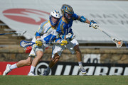 Tom Croonquist #45 of the Florida Launch pressures Kevin Drew #19 of the Charlotte Hounds during their game at American Legion Memorial Stadium on July 11, 2015 in Charlotte, North Carolina. Florida won 17-16 in overtime.