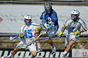 Tom Croonquist #45 and PT Ricci #1 of the Florida Launch pressure Kevin Drew #19 of the Charlotte Hounds during their game at American Legion Memorial Stadium on July 11, 2015 in Charlotte, North Carolina. Florida won 17-16 in overtime.