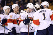 Jared McCann #90 of the Florida Panthers celebrates with Roberto Luongo #1 after the Panthers defeat the Boston Bruins 4-2 at TD Garden on April 8, 2018 in Boston, Massachusetts.