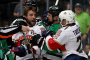 Aaron Ekblad #5 of the Florida Panthers and Vincent Trocheck #21 of the Florida Panthers fight with Jamie Benn #14 of the Dallas Stars in the first period at American Airlines Center on January 23, 2018 in Dallas, Texas.