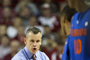 Head Coach Billy Donovan of the Florida Gators instructs his players going into the game against the Arkansas Razorbacks at Bud Walton Arena on January 11, 2014 in Fayetteville, Arkansas.  The Gators defeated the Razorbacks 84-82.