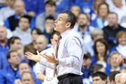 Billy Donovan the head coach of the Florida Gators gives instructions to his team during the game against the Kentucky Wildcats at Rupp Arena on March 9, 2013 in Lexington, Kentucky.