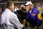 Les Miles Jim McElwain Photos - 1 of 2 Photo