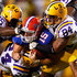 Harry Coleman Photos - Quarterback Tim Tebow #15 of the Florida Gators is tackled by Lazarius Levingston #95, Harry Coleman #24 and Rahim Alem #84 of the Louisiana State University Tigers at Tiger Stadium on October 10, 2009 in Baton Rouge, Louisiana. - Florida v LSU
