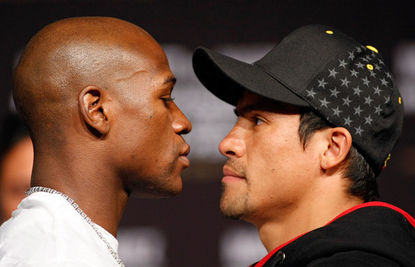 Mayweather v Marquez News Conference [nose,interaction,ear,headgear,kiss,gesture,baseball cap,hat,cap,boxers,floyd mayweather jr,juan manuel marquez,two,las vegas,casino,mgm grand hotel,mgm grand garden arena,mayweather v marquez news conference,news conference]