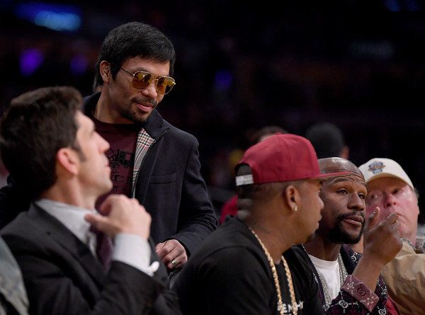 Golden State Warriors v Los Angeles Lakers [photograph,event,human,interaction,audience,crowd,performance,competition event,championship,manny pacquiao,user,user,floyd mayweather jr.,note,terms,golden state warriors,los angeles lakers,game]