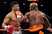 (R-L) Floyd Mayweather Jr. connects with a left to the face of Victor Ortiz during their WBC welterweight title fight at the MGM Grand Garden Arena on September 17, 2011 in Las Vegas, Nevada.
