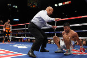 (C) Referee Joe Cortez calls the fight after (L) Victor Ortiz is knocked out by Floyd Mayweather Jr. during their WBC welterweight title fight at the MGM Grand Garden Arena on September 17, 2011 in Las Vegas, Nevada.