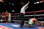 (C) Referee Joe Cortez calls the fight after (R) Victor Ortiz is knocked out by Floyd Mayweather Jr. during their WBC welterweight title fight at the MGM Grand Garden Arena on September 17, 2011 in Las Vegas, Nevada.