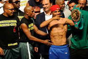 (L-R) Boxer Floyd Mayweather Jr. and Victor Ortiz pose after the weigh-in for their WBC welterweight title fight at the MGM Grand Garden Arena on September 16, 2011 in Las Vegas, Nevada. Mayweather and Ortiz will meet in a 12-round bout on September 17, 2011 in Las Vegas, Nevada.