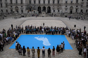 """Members of the public attend an opening event for the """"Fly The Flag"""" project, a major new project for which artist and activist Ai Weiwei has designed a new flag at Somerset House on June 24, 2019 in London, England. The project marks the 70th anniversary of the Universal Declaration of Human Rights."""