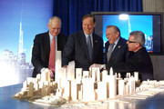 Architect and designer Daniel Libeskind (R) stands with WTC leaseholder Larry Silverstein (2nd-R),  New York State Governor George Pataki (3rd-R) and architect David Childs (R) as they look at a model of the re-built World Trade Center site December 19, 2003 at Federal Hall in New York City. The Freedom Tower will be built on the World Trade Center site and will rise 1,776 feet intio the sky becoming the world's tallest building. The building will contain 2.6 million square feet of office space on 60 stories and the top floors will house roof top restaurants and a public observation deck.