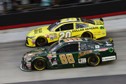 Matt Kenseth, driver of the #20 Dollar General Toyota, leads Dale Earnhardt Jr., driver of the #88 Mountain Dew Dewshine Chevrolet, during the NASCAR Sprint Cup Series Food City 500 at Bristol Motor Speedway on April 19, 2015 in Bristol, Tennessee.